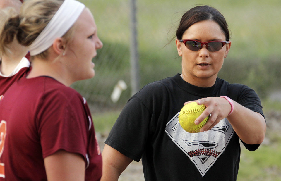 Photo - Coach Mandy Fulton gives instructions near catcher Jayci Wehrenberg, left, at practice for the OKC Strikkers softball team in Oklahoma City, Thursday, May 27, 2010.  Mandy Fulton was a member of OU's national championship softball team in 2000. Photo by Nate Billings, The Oklahoman
