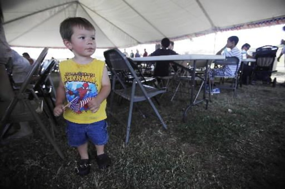 Christopher Freer, 2, at a Fourth of July Celebration in Seminole, Okla., July 4, 2012. Photo by Garett Fisbeck, The Oklahoman