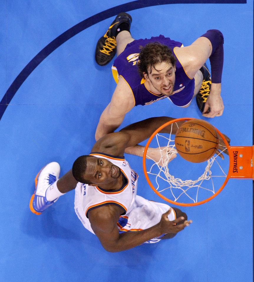 Oklahoma City's Serge Ibaka (9) watches the ball go in beside Los Angeles' Pau Gasol (16) during Game 1 in the second round of the NBA playoffs between the Oklahoma City Thunder and L.A. Lakers at Chesapeake Energy Arena in Oklahoma City, Monday, May 14, 2012. Photo by Bryan Terry, The Oklahoman