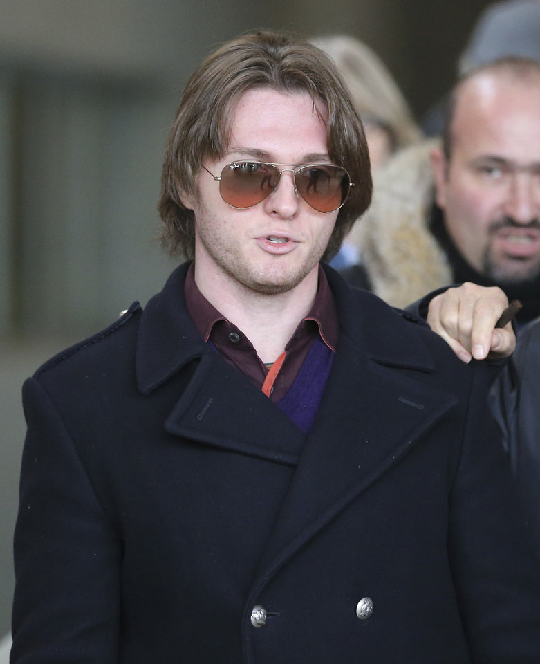 Photo - FILE - In this Thursday, Jan. 30, 2014 file photo, Raffaele Sollecito leaves after attending the final hearing before the third court verdict for the murder of British student Meredith Kercher, in Florence, Italy. An Italian court that convicted Amanda Knox in her roommate's 2007 murder says the wounds indicate multiple aggressors, and that the two exchange students fought over money the night of the murder. The appellate court in Florence on Tuesday, April 29, 2014, issued a 337-page explanation for its January guilty verdicts against the American and her former boyfriend Raffaele Sollecito. The release of the court's reasoning opens the verdict to an appeal back to the supreme Court of Cassation. If it confirms the convictions, a long extradition fight for Knox is expected. She has been in the United States since 2011 when her earlier conviction was overturned. British student Meredith Kercher, 21, was found dead in a pool of blood in the apartment she and Knox shared in the town of Perugia. (AP Photo/Antonio Calanni, File)