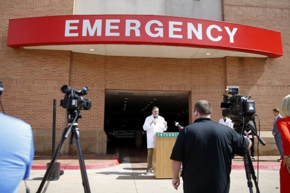 Photo - infectious disease physician David Chansolme with Integris speaks during a COVID-19 press conference in front of Integris Baptist Medical Center in Oklahoma City, Wednesday, March 18, 2020. [Bryan Terry/The Oklahoman]
