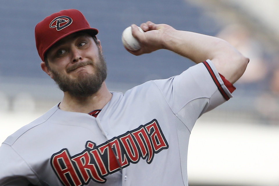 Photo - Arizona Diamondbacks starting pitcher Wade Miley throws against the Pittsburgh Pirates in the second inning of the baseball game on Tuesday, July 1, 2014, in Pittsburgh. (AP Photo/Keith Srakocic)
