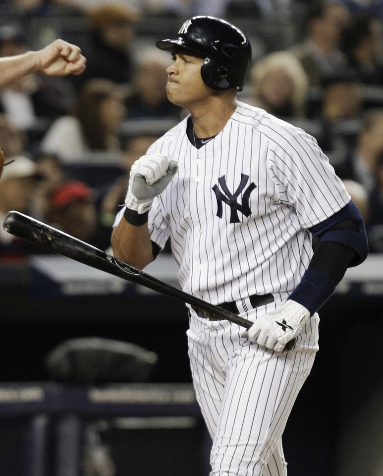 Photo -   New York Yankees' Alex Rodriguez reacts after striking out during the fourth inning of Game 3 of the American League division baseball series against the Baltimore Orioles on Wednesday, Oct. 10, 2012, in New York. (AP Photo/Kathy Willens)