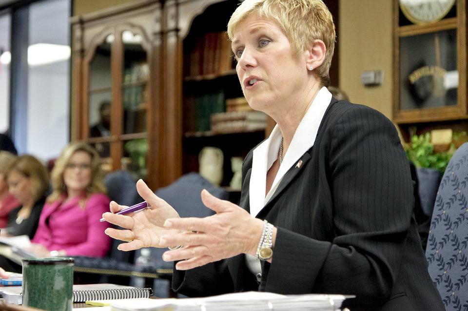 Photo - Oklahoma state schools Superintendent Janet Barresi speaks Thursday during  an Education Board meeting in Oklahoma City.  Photo by Chris Landsberger, The Oklahoman