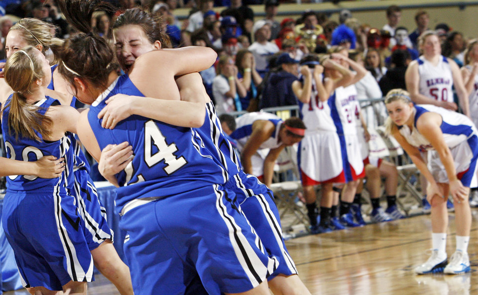 The Lomega Raiderettes celebrate in front of the Hammon Lady Warriors after the Class B state championship girls high school basketball game between Hammon and Lomega at State Fair Arena in Oklahoma City, Saturday, March 3, 2012. Lomega won, 49-44. Photo by Nate Billings, The Oklahoman