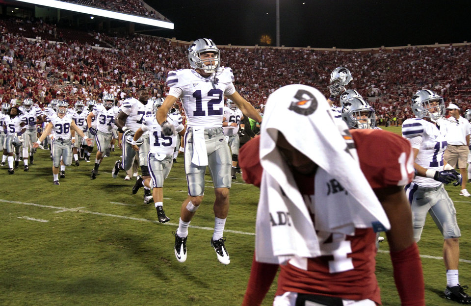 Photo - Ty Zimmerman (12) and teammates celebrate and Aaron Colvin (14) walks off  with his head bowed after the college football game where the University of Oklahoma Sooners (OU) lost 24-19 to the Kansas State University Wildcats (KSU) at Gaylord Family-Oklahoma Memorial Stadium, Saturday, September 22, 2012. Photo by Steve Sisney, The Oklahoman