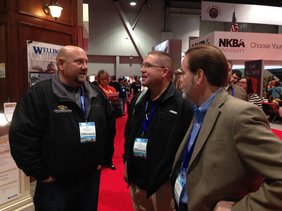 Photo - Mike Gilles, left, and Dan Reeves, right, talk with a Texas builder on the exhibit floor of the Last Vegas Convention Center during the International Builders Show.   Photo PROVIDED BY MIKE MEANS/OKLAHOMA STATE HOME BUILDERS ASSOCIATION   - PROVIDED BY MIKE MEANS/OKLAHOMA STATE HOME BUILDERS ASSOCIATION