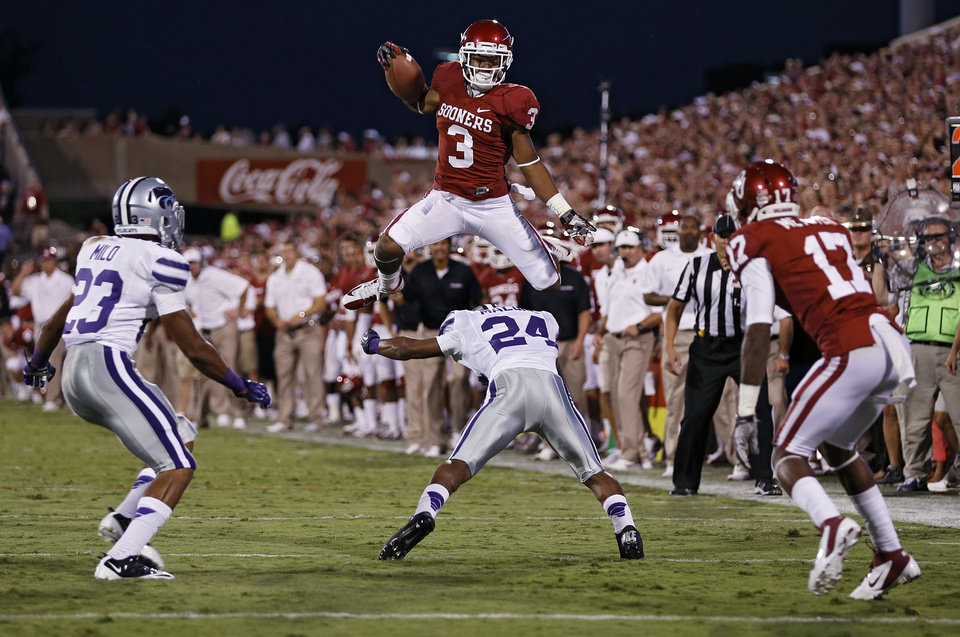 Oklahoma\'s Sterling Shepard (3) leaps over Kansas State\'s Nigel Malone (24) during the college football game between the University of Oklahoma Sooners (OU) and the Kansas State University Wildcats (KSU) at the Gaylord Family-Oklahoma Memorial Stadium on Saturday, Sept. 22, 2012, in Norman, Okla. Photo by Chris Landsberger, The Oklahoman