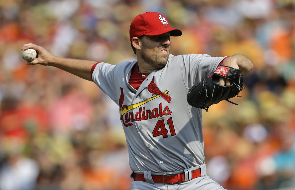 Photo - St. Louis Cardinals starting pitcher John Lackey throws to the Baltimore Orioles in the first inning of an interleague baseball game, Saturday, Aug. 9, 2014, in Baltimore. (AP Photo/Patrick Semansky)