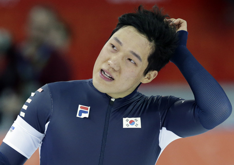 Photo - South Korea's Mo Tae-bum reacts after competing in the second heat of the men's 500-meter speedskating race at the Adler Arena Skating Center at the 2014 Winter Olympics, Monday, Feb. 10, 2014, in Sochi, Russia.(AP Photo/Matt Dunham)