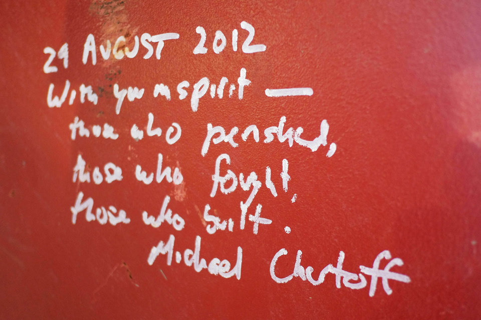 Photo - This Jan. 15, 2013 photo shows graffiti left by Michael Chertoff, the former director of Homeland Security, on a steel column on the 104th floor of One World Trade Center in New York. Construction workers finishing New York's tallest building at the World Trade Center are leaving their personal marks on the concrete and steel in the form of graffiti. (AP Photo/Mark Lennihan)
