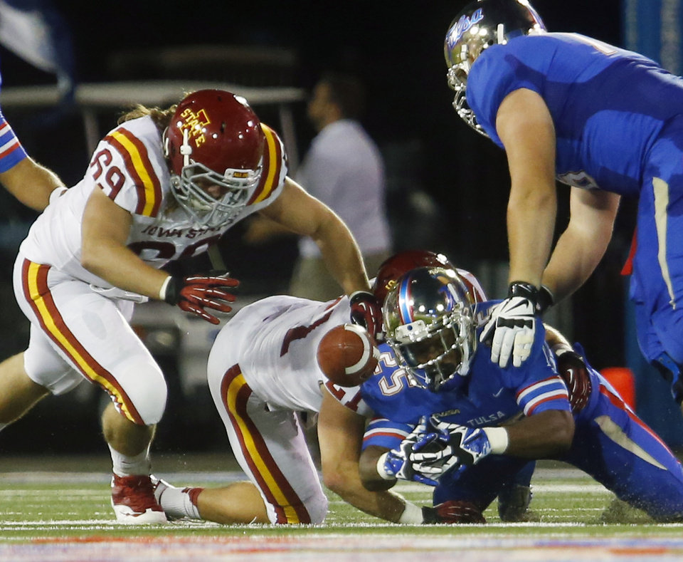 Photo - Iowa State's Nick Kron (69) recovers a dumber between Cody Green and Ja'Terian Douglas during the first half of an NCAA college football game, Thursday, Sept. 26, 2013 in Tulsa, Okla. (AP Photo/Tulsa World, Tom Gilbert)  ONLINE OUT; TV OUT; TULSA OUT