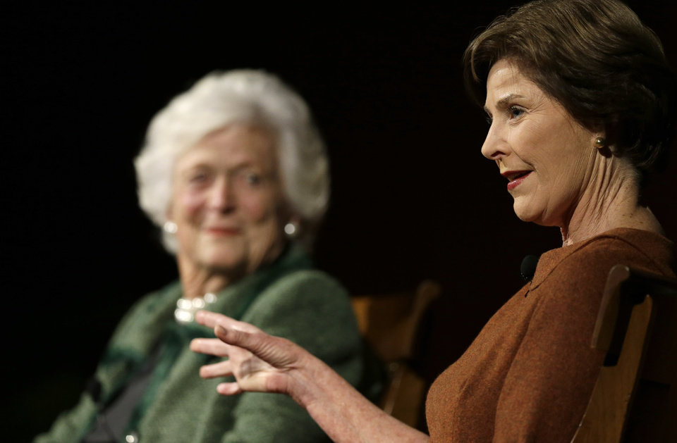 Former first ladies Barbara Bush, left, and Laura Bush, right, take part in the Enduring Legacies of America's First Ladies conference Thursday, Nov. 15, 2012, in Austin, Texas. Family members, former staff members, historians, and White House insiders also spoke as part of the program. (AP Photo/David J. Phillip)