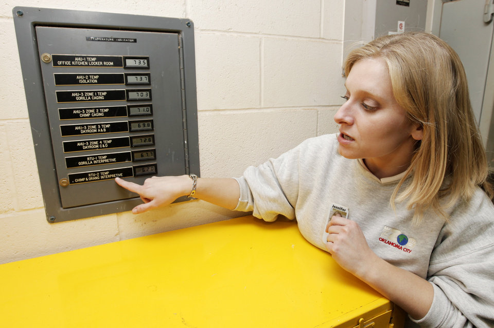 Photo - WINTER / COLD WEATHER: Jennifer D'Agostino, director of veterinary services, shows a temperature indicator panel inside the Great EscApe building at the Oklahoma City Zoo where zookeepers can check the temperature of animal habitats in Oklahoma City, Tuesday, January 26, 2010. Photo by Nate Billings, The Oklahoman ORG XMIT: KOD