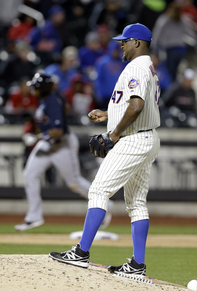 Photo - New York Mets relief pitcher Jose Valverde (47) reacts as Atlanta Braves' Justin Upton heads to home plate after hitting a three-run home run during the ninth inning of a baseball game Saturday, April 19, 2014, in New York. (AP Photo/Frank Franklin II)