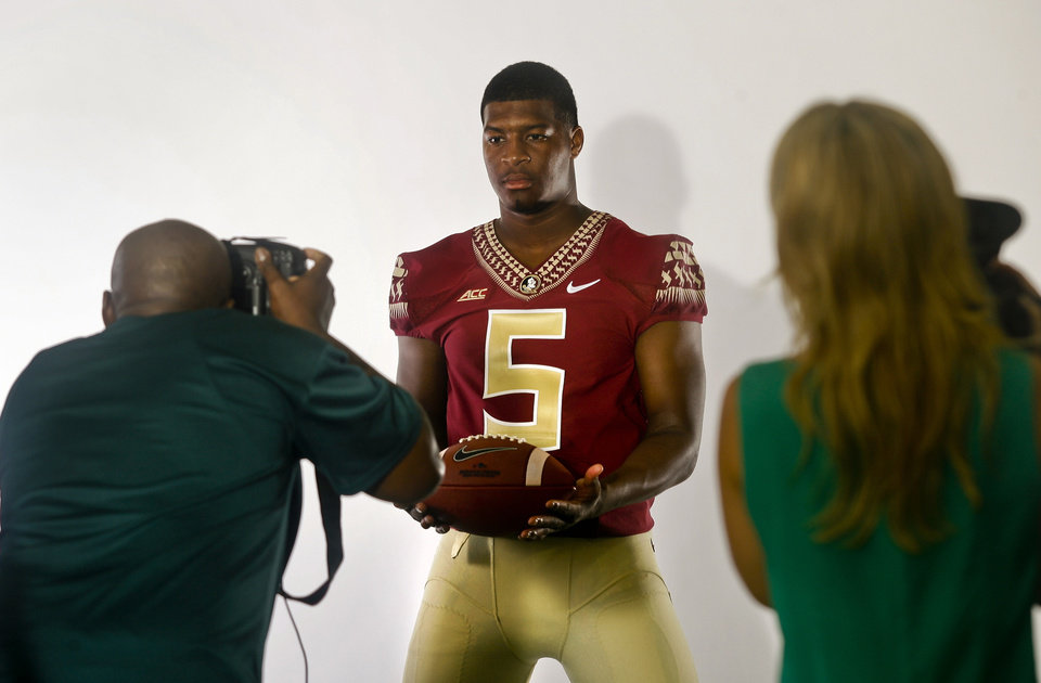 Photo - Florida State quarterback Jameis Winston (5) poses for a photo during their NCAA college football media day on Sunday, Aug. 10, 2014, in Tallahassee, Fla. (AP Photo/Phil Sears)