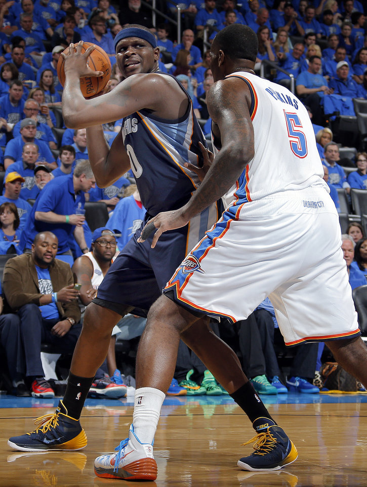 Photo - Zach Randolph (50) looks to pass around Oklahoma City's Kendrick Perkins (5) during Game 1 in the first round of the NBA playoffs between the Oklahoma City Thunder and the Memphis Grizzlies at Chesapeake Energy Arena in Oklahoma City, Saturday, April 19, 2014. Photo by Sarah Phipps, The Oklahoman