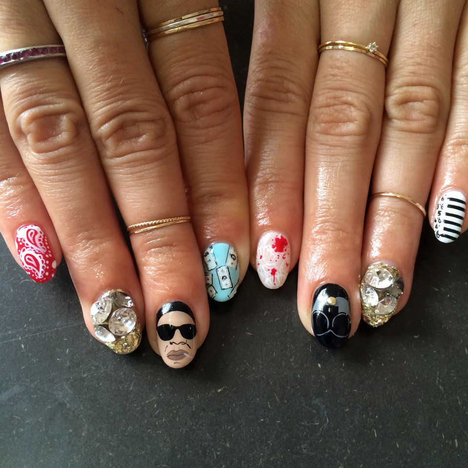 """Photo - This product image released by Nails By Mei shows a fingernail design theme for a Jay Z and Beyonce concert, created by Miho """"Mei"""" Kawajiri. Move over, studded bracelets and chandelier earrings. Right now, it's all about nails. Rhinestones, 3-D designs, textured topcoats and new offerings from fashion royalty have upped the ante on fingertips. (AP Photo/Nails By Mei)"""