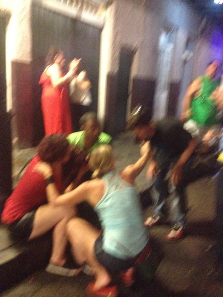 Photo - This photo released by David Minsky shows victims being assisted moments after a shooting on Bourbon Street early Sunday morning, June 29, 2014,  that left nine people injured. (AP Photo/David Minsky)