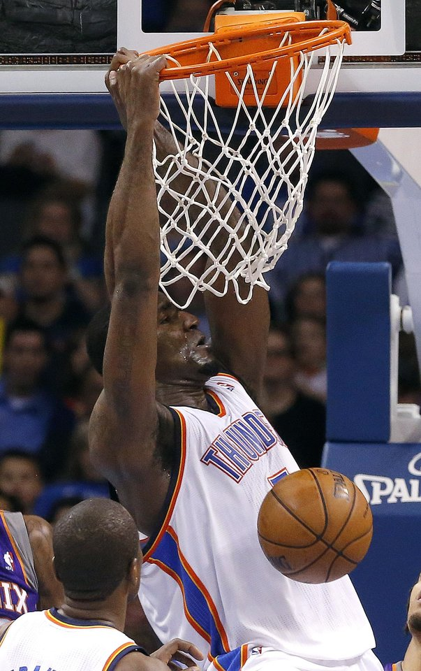 Photo - Oklahoma City's' Kendrick Perkins (5) dunks the ball during the NBA game between the Oklahoma City Thunder and the Phoenix Suns at theChesapeake Energy Arena, Friday, Feb. 8, 2013.Photo by Sarah Phipps, The Oklahoman