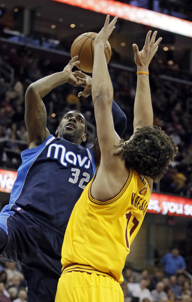 Dallas Mavericks' O.J. Mayo (32) loses the ball on a shot against Cleveland Cavaliers' Anderson Varejao, from Brazil, in the first quarter of an NBA basketball game on Saturday, Nov. 17, 2012, in Cleveland. (AP Photo/Mark Duncan)