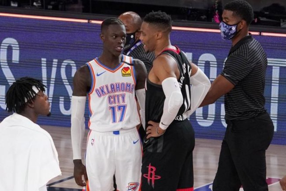 Photo -  Oklahoma City Thunder's Dennis Schroder (17) and Houston Rockets' Russell Westbrook, center right, talk after their NBA first-round playoff basketball game in Lake Buena Vista, Fla., Wednesday, Sept. 2, 2020. (AP Photo/Mark J. Terrill)
