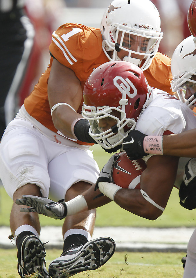 Texas' Keenan Robinson (1) tries to stop Oklahoma's Dominique Whaley (8) during the Red River Rivalry college football game between the University of Oklahoma Sooners (OU) and the University of Texas Longhorns (UT) at the Cotton Bowl in Dallas, Saturday, Oct. 8, 2011. Photo by Chris Landsberger, The Oklahoman