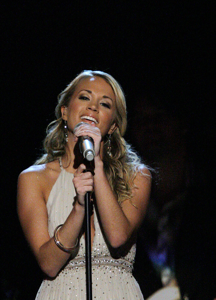 Photo - Carrie Underwood performs during the Centennial Spectacular to celebrate the 100th birthday of the State of Oklahoma at the Ford Center on Friday, Nov. 16, 2007, in Oklahoma City, Okla. Photo By CHRIS LANDSBERGER, The Oklahoman