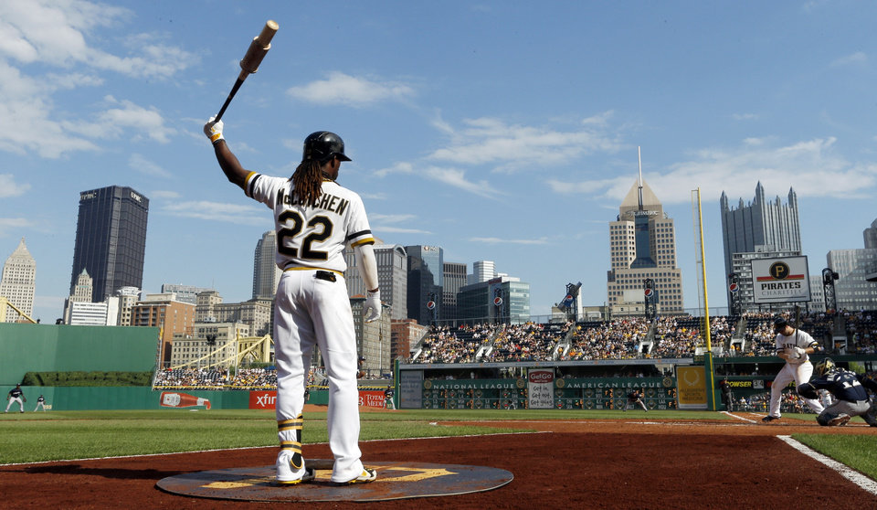 Photo - In this photo from Sunday, June 30, 2013, Pittsburgh Pirates' Andrew McCutchen (22) warms up in the on deck circle at PNC Park during a baseball game against the Milwaukee Brewers on  in Pittsburgh. The Pirates won this game, 2-1 in 14 innings, stretching their current win streak to nine games. The team with the best record in baseball isn't trying to think too far down the road. After 20 seasons of losing, the first-place Pittsburgh Pirates are just trying to enjoy the moment. (AP Photo/Keith Srakocic)