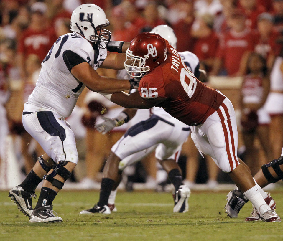 Photo - Oklahoma's Adrian Taylor (86) puts the pressure on Utah State offensive lineman Tyler Larsen (75) during the second half of the college football game between the University of Oklahoma Sooners (OU) and Utah State University Aggies (USU) at the Gaylord Family-Oklahoma Memorial Stadium on Saturday, Sept. 4, 2010, in Norman, Okla.   Photo by Chris Landsberger, The Oklahoman