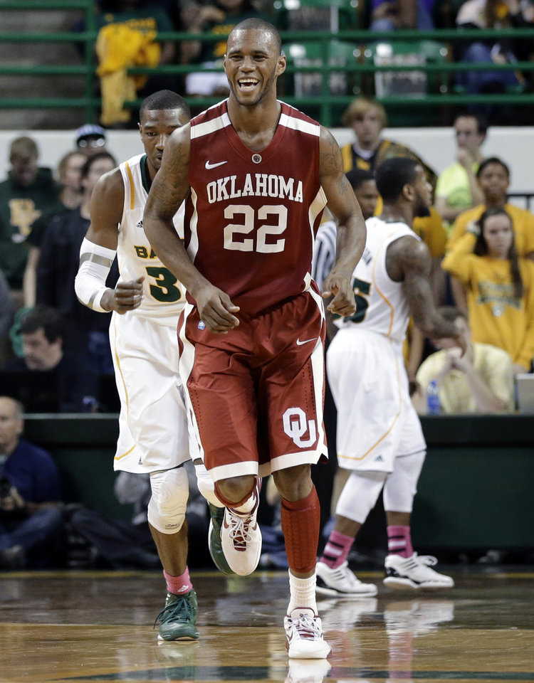 Oklahoma \'s Amath M\'Baye (22) smiles as he runs back up court after sinking a three-point basket in the second half of an NCAA college basketball game against Baylor Wednesday, Jan. 30, 2013, in Waco, Texas. Baylor\'s Cory Jefferson, left rear, and Pierre Jackson, right rear, are shown behind on the play. Oklahoma won 74-71. (AP Photo/Tony Gutierrez) ORG XMIT: TXTG114