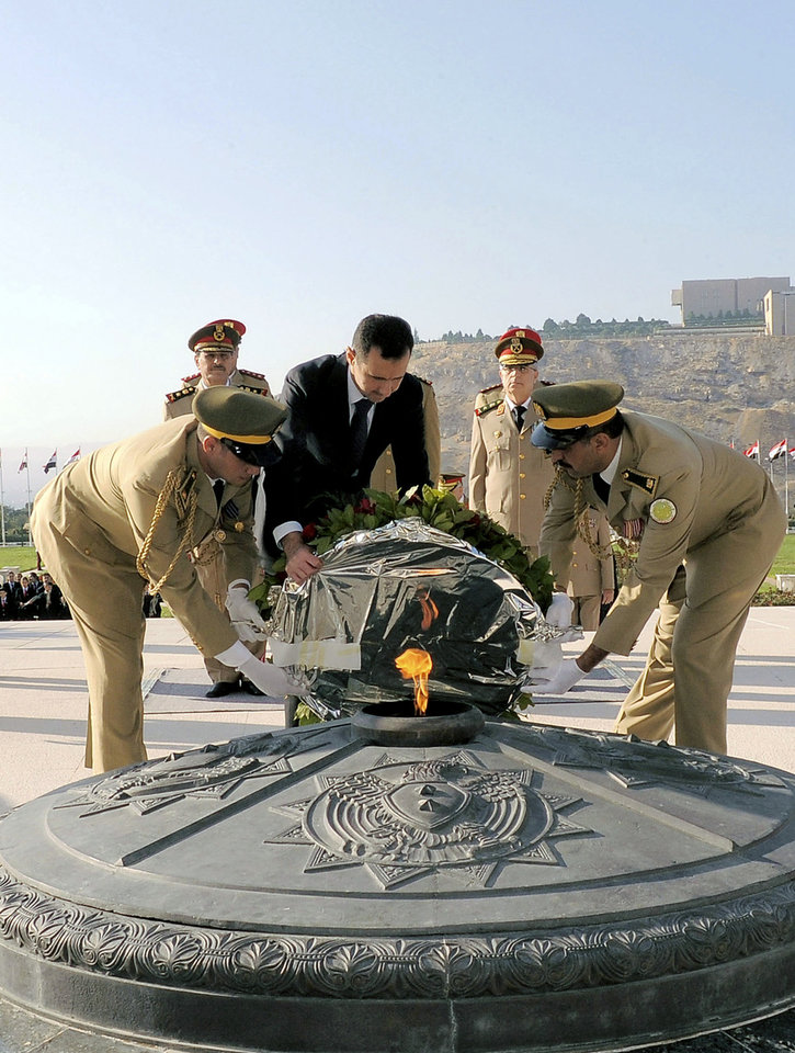Photo -   In this photo released by the Syrian official news agency SANA, Syrian President Bashar Assad lays a wreath at the tomb of the unknown soldier marking the anniversary of the 1973 Arab-Israeli war in Damascus, Syria, Saturday, October, 6, 2012. (AP Photo/SANA)