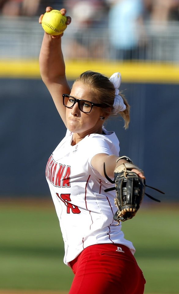 Photo - La.-Lafayette's Christina Hamilton pitches during a Women's College World Series game at ASA Hall of Fame Stadium in Oklahoma City Thursday, May 29,2014. Photo by Bryan Terry, The Oklahoman