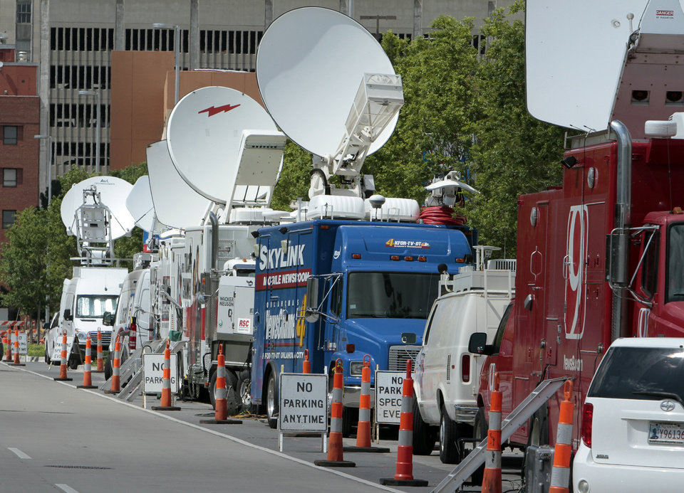 Photo - Satellite trucks are parked on June 13 along Robinson Avenue west of the Cox Convention Center ahead of the NBA Finals in Oklahoma City. Photo by  Steve Sisney,  The Oklahoman