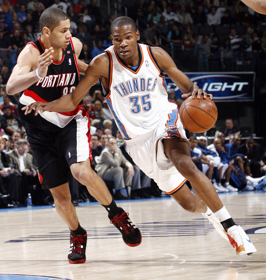 Photo - Oklahoma City's Kevin Durant (35) tries to dribble past Nicolas Batum (88) of Portland during the NBA basketball game between the Oklahoma City Thunder and the Portland Trail Blazers at the Ford Center in Oklahoma City, Friday, February 6, 2009. BY NATE BILLINGS, THE OKLAHOMAN
