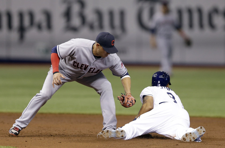 Photo - Tampa Bay Rays' Desmond Jennings, right, slides into second base ahead of the tag by Cleveland Indians shortstop Asdrubal Cabrera during the third inning of a baseball game on Saturday, May 10, 2014, in St. Petersburg, Fla. (AP Photo/Chris O'Meara)
