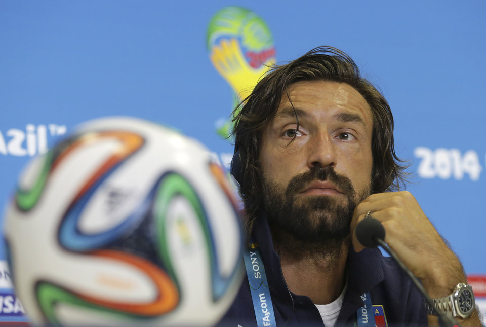 Photo - Italy's Andrea Pirlo listens to a question during a press conference at the Arena das Dunas in Natal, Brazil, Monday, June 23, 2014.  (AP Photo/Antonio Clanni)