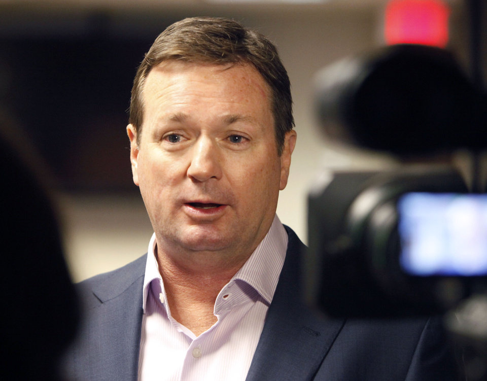 Photo - OU coach Bob Stoops speaks to the press during a legislative luncheon on Children's Hospital at the State Capitol in Oklahoma City, OK, Thursday, March 13, 2014,  Photo by Paul Hellstern, The Oklahoman