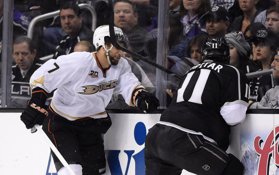 Photo - Los Angeles Kings center Anze Kopitar, right, of Slovenia, hits Anaheim Ducks center Andrew Cogliano in the face with his stick during the third period in Game 4 of an NHL hockey second-round Stanley Cup playoff series, Saturday, May 10, 2014, in Los Angeles. Kopitar received a four minute double minor for high sticking on the play. The Duck won 2-0. (AP Photo/Mark J. Terrill)