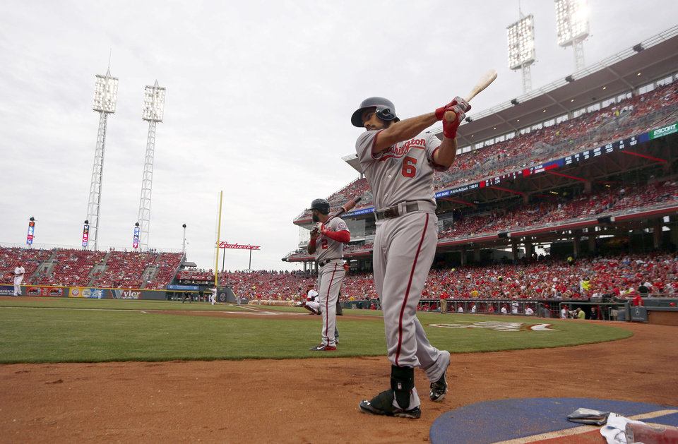 Photo - Washington Nationals' Denard Span (2) and Anthony Rendon (6) prepare on deck at the beginning of a baseball game against the Cincinnati Reds, Friday, July 25, 2014, in Cincinnati. (AP Photo/David Kohl)