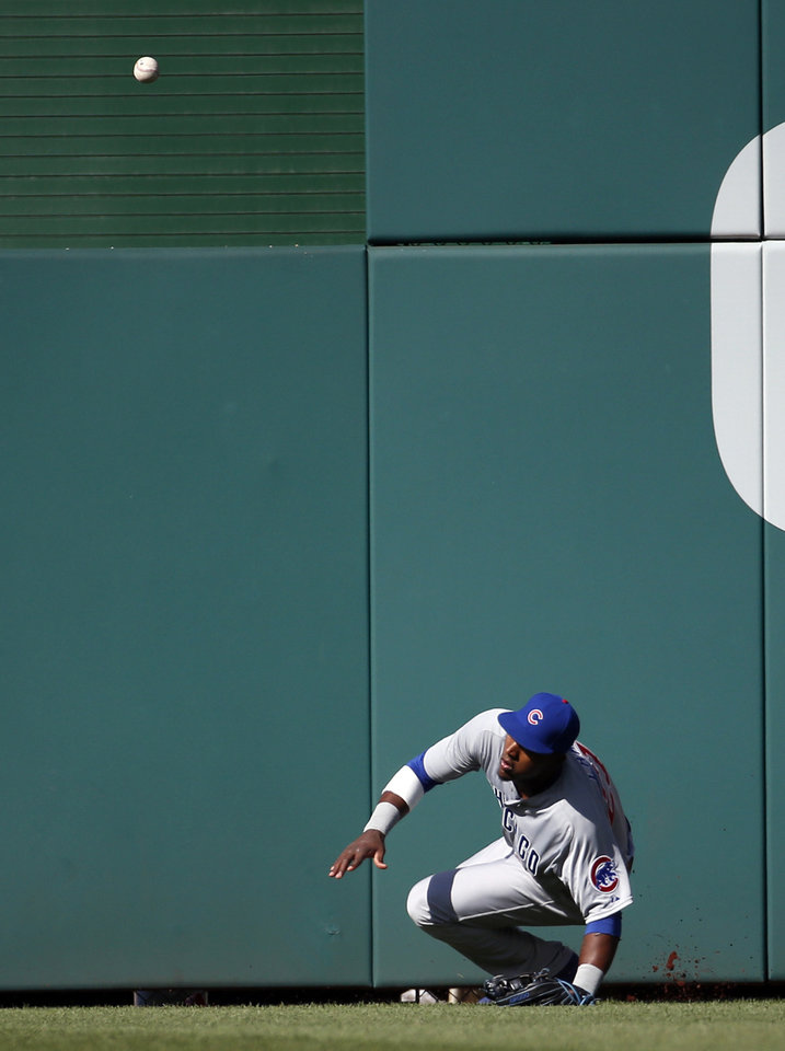 Photo - Chicago Cubs center fielder Junior Lake falls as an RBI double by Washington Nationals' Jayson Werth bounces off the wall and over his head, during the third inning of a baseball game at Nationals Park, Saturday, July 5, 2014, in Washington. (AP Photo/Alex Brandon)
