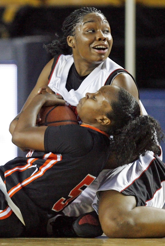 Photo - Ashley Baker of East Central, top, looks to an official for a call after trying to take the ball from Kami Bunch of Booker T. Washington during the Class 5A girls high school basketball state tournament semifinal game between East Central and Booker T. Washington at the ORU Mabee Center in Tulsa, Okla., Friday, March 12, 2010. East Central won, 53-38. Photo by Nate Billings, The Oklahoman ORG XMIT: KOD