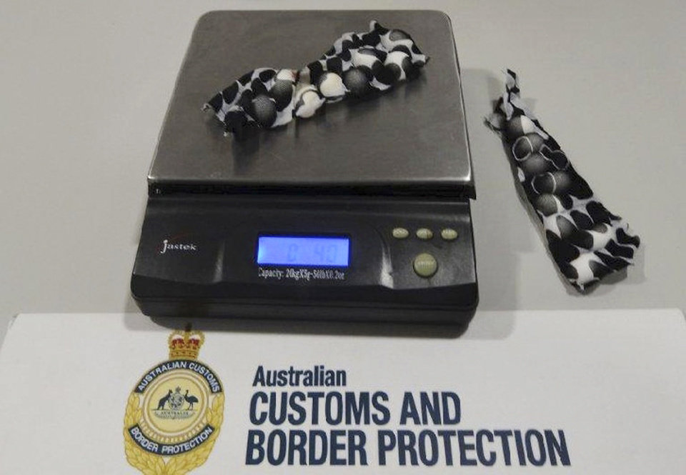Photo - This Tuesday, May 20, 2014 photo provided by Australian Customs and Boarder Protection Service shows small bird eggs hidden in strips of fabric which were removed from a traveler at Sydney international airport after he arrived from Dubai. A 39-year-old Czech man arrived Tuesday on a flight from Dubai when customs officials selected him for a baggage examination, Australian Customs and Border Protection Service said in a statement.