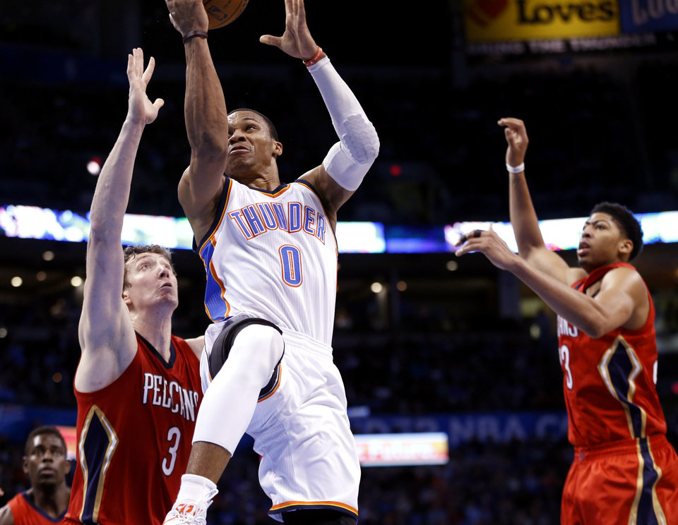 Photo - Thunder's Russell Westbrook (0) drives during the second half of an NBA basketball game between the Oklahoma City Thunder and the New Orleans Pelicans at Chesapeake Energy Arena on Dec. 21, 2014 in Oklahoma City, Okla. Photo by Steve Sisney, The Oklahoman