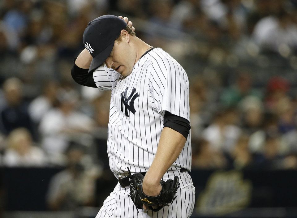Photo - New York Yankees relief pitcher Shawn Kelley reacts after New York Yankees manager Joe Girardi took him out in the fifth inning of a baseball game against the Boston Red Sox at Yankee Stadium in New York, Sunday, June 29, 2014. (AP Photo/Kathy Willens)