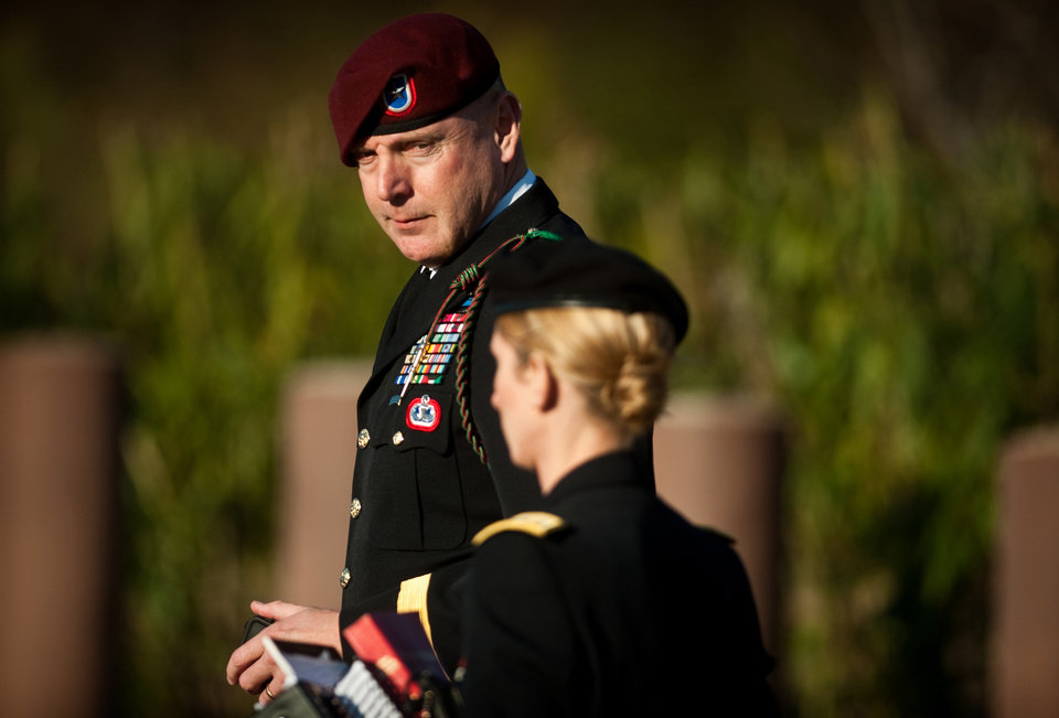 Army Brig. Gen. Jeffrey A. Sinclair, left, leaves a Fort Bragg, N.C. courthouse with a member of his defense team, Maj. Elizabeth Ramsey, Tuesday, Jan. 22, 2013, after he deferred entering a plea at his arraignment on charges of fraud, forcible sodomy, coercion and inappropriate relationships. Sinclair, who served five combat tours, is headed to trial following a spate of highly publicized military sex scandals involving high-ranking officers that has triggered a review of ethics training across the service branches. (AP Photo/The Fayetteville Observer, Andrew Craft) MAGS OUT, NO SALES