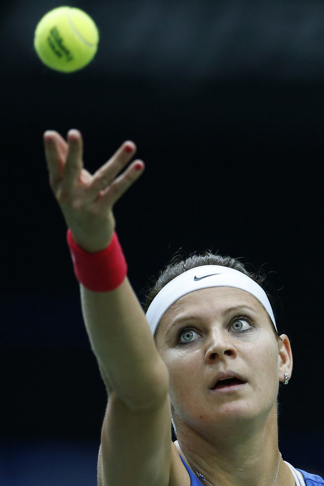 Photo - Czech Republic's Lucie Safarova serves a ball to Italy's Sara Errani during the Fed Cup semifinals in Ostrava, Czech Republic, Saturday, April 19, 2014. (AP Photo/Petr David Josek)