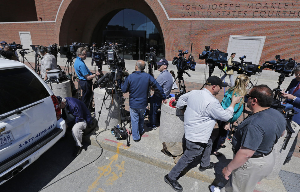 Photo - Television cameramen wait outside the Moakley Federal Courthouse in Boston, Mass., Wednesday, May 1, 2013.  Three suspects were taken into custody in the Boston Marathon bombing case including two college friends of Dzhokhar Tsarneav, according to officials.  (AP Photo/Charles Krupa)