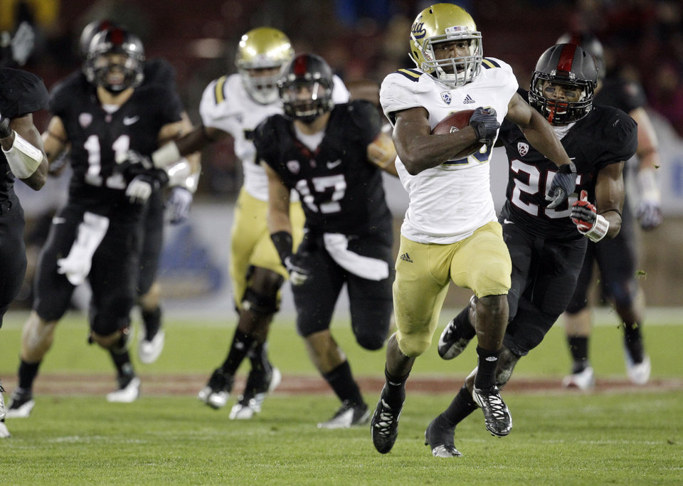 Photo - UCLA running back Johnathan Franklin (23) dashes for a 51-yard touchdown against Stanford during the first half of the Pac-12 championship NCAA college football game in Stanford, Calif., Friday, Nov. 30, 2012. (AP Photo/Tony Avelar)