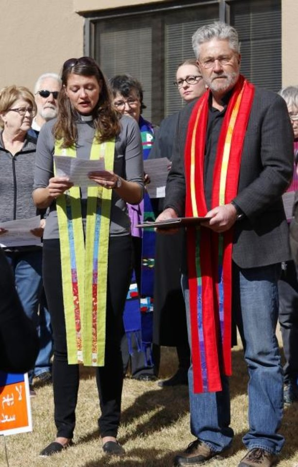 Photo -  In this 2018 photo, the Rev. Robin Meyers, senior pastor of Mayflower Congregational Church-United Church of Christ, at right, leads a prayer vigil outside an unmarked Immigration and Customs Enforcement office, along with the Rev. Lori Walke, Mayflower's associate minister. [Doug Hoke/ The Oklahoman Archives]